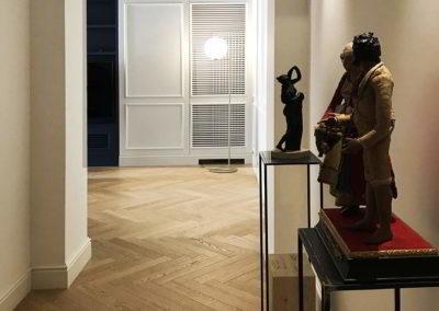 Officine Architetti Napoli_ingresso con boiserie e piedistalli